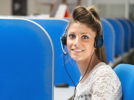 smiling girl operator in call center