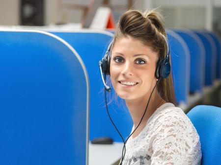 center: smiling girl operator in call center