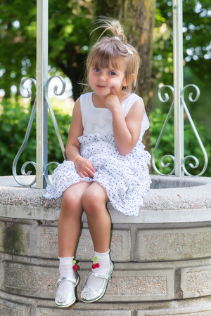 Cute little girl making funny face photo