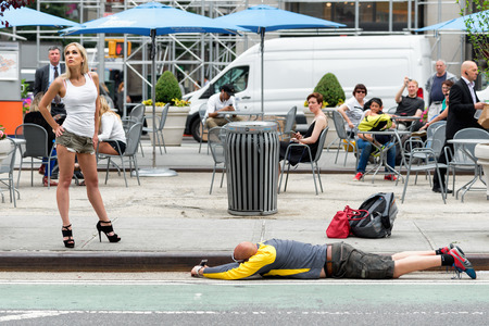 strange: NEW YORK CITY - JUNE 16, 2015: strange kind of shooting on the street with mobile phone