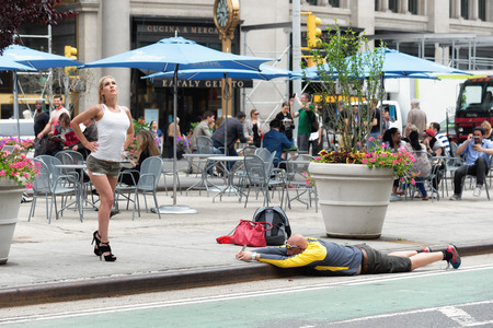 photo shooting: NEW YORK CITY - JUNE 16, 2015: strange kind of shooting on the street with mobile phone