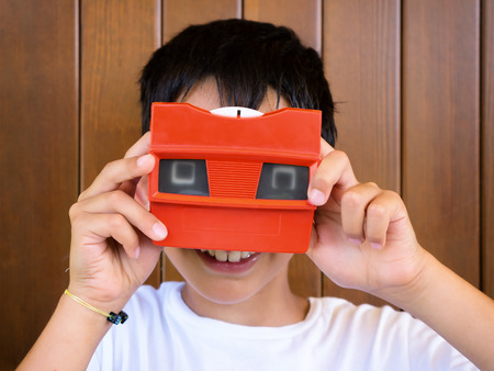 little boy playing with vintage 3d viewer Stock Photo