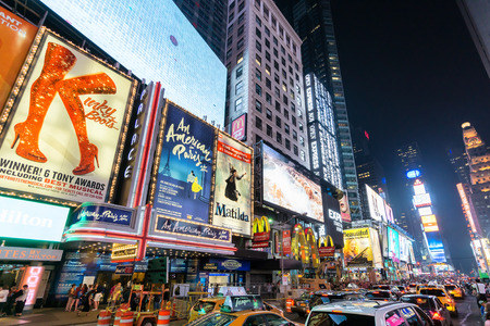 broadway show: NEW YORK CITY - JUNE 12, 2015: Times Square at night featuring lighted billboards of the broadway best show