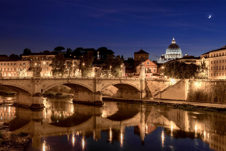 pietro: Night view of St. Peters cathedral in Rome, Italy Stock Photo