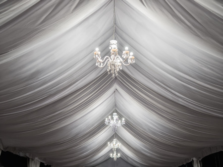 classic chandeliers on event party tent
