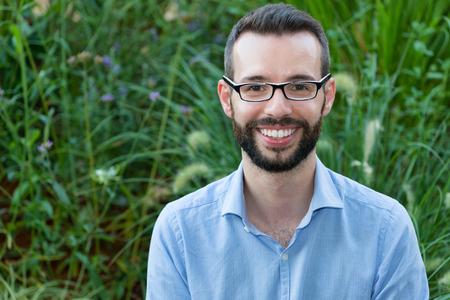 smiling businessman: Smiling Young Businessman Wearing Eyeglasses
