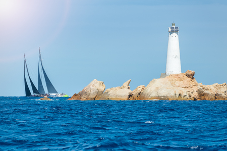 porto: sailing in Sardinia, Monaci island lighthouse, Italy