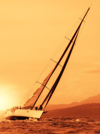 sailing yacht at sunset on the sea