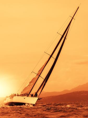 romance sky: sailing yacht at sunset on the sea