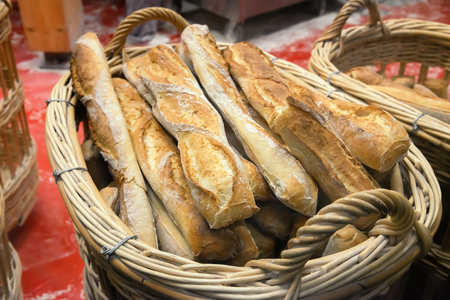french bakery: French baguettes on basket in bakery