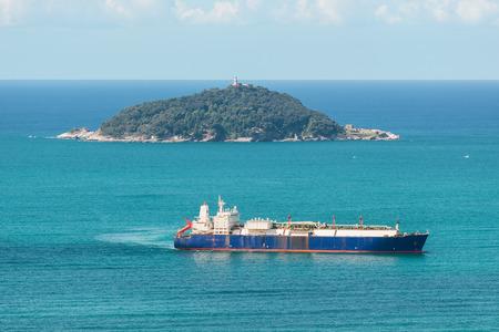 tanker ship: tanker ship sailing in the sea near an island