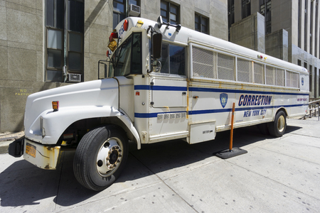 incarceration: NEW YORK CITY- JUNE 13, 2015: Correction Department bus parked in front of New York City Criminal Court Editorial