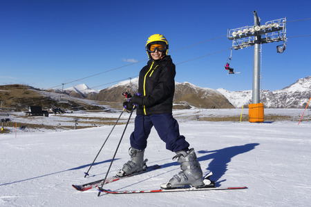 to ski: Skiing boy with ski mask and helmet
