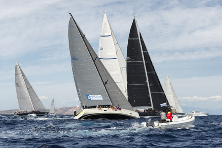 maxi: PORTO CERVO - 8 SEPTEMBER: teams competing on Maxi Yacht Rolex Cup sail boat race in Sardinia, on September 8 2015 in Porto Cervo, Italy