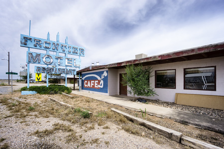 frontier: TRUXTON, ARIZONA, USA - JUNE 10, 2016: abandoned Frontier Motel and Cafe on Route 66. Route 66 is a famous road attracting travelers from all of the world.