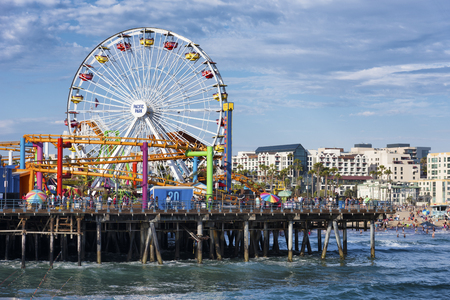 19 years: SANTA MONICA, USA - JUNE 19: The amusement park on the Santa Monica Pier, Los Angeles California on June 19, 2016. The pier is popular as a landmark that is over 100 years old