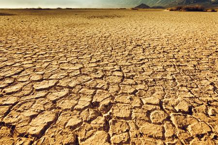arid climate: cracked and arid soil landscape Stock Photo