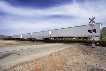goods train: long cargo train moving goods containers Stock Photo