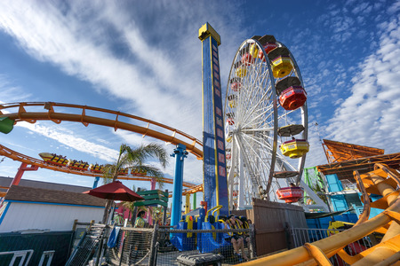 19 years old: SANTA MONICA, USA - JUNE 19: The amusement park on the Santa Monica Pier, Los Angeles California on June 19, 2016. The pier is popular as a landmark that is over 100 years old
