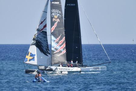 deportes nauticos: Génova, Italia - 25 de septiembre: último día de la competencia para la serie M32 mediterráneo, una competición de vela catamarán rápido organizada durante Génova salón náutico de 2016. el 25 de septiembre, 2016, Génova, Italia. Editorial