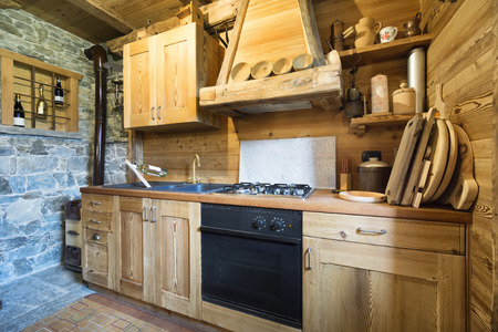 logs: wooden kitchen in rustic style