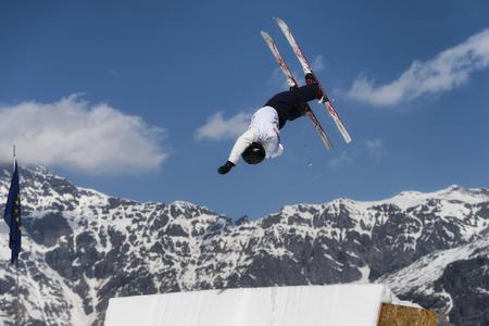 extreme sports: CHIESA VALMALENCO, ITALY - MARCH 31, 2017: Freestyle Ski FIS European Cup, athlete jump