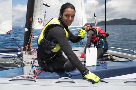 PUNTA ALA - 3 JUNE: woman on sail boat during Formula 18 national catamaran regatta, on June 3 2016 in Punta Ala, Italy Editorial