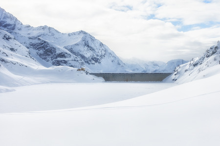 Gabiet lake dam, winter landscape. Gressoney, Italy