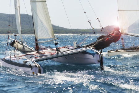 Sailing boat race, catamaran in regatta 스톡 콘텐츠