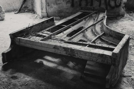 old piano in an abandoned house