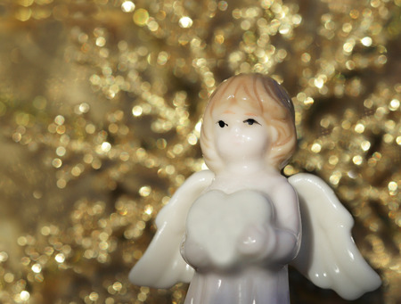 white angel figure on christmas light background