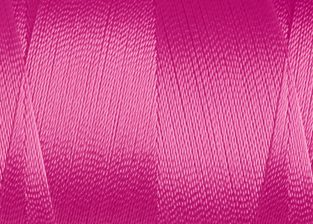 texture of synthetic thread in spool, macro