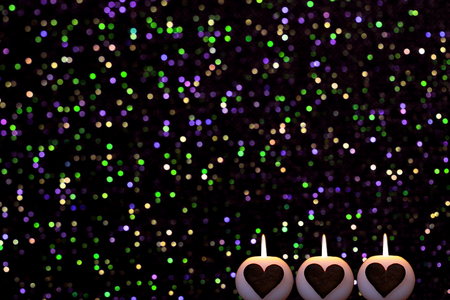 romantic colorful bokeh circles with candles