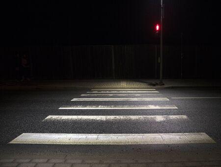 zebra crosswalk at night , red light
