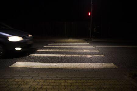 car at zebra crosswalk at night , red light Banque d'images