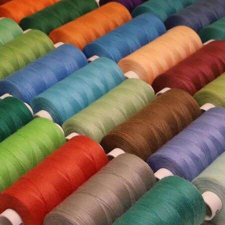 Different colors sewing threads in spools
