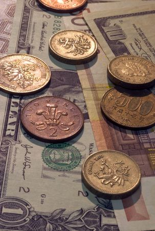 Different currency in bills and coins Stock fotó