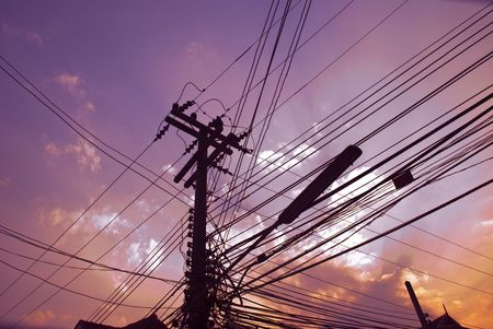 poll: A busy hub for wires on a sunset sky Stock Photo