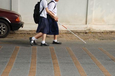 Blind friends walking together photo