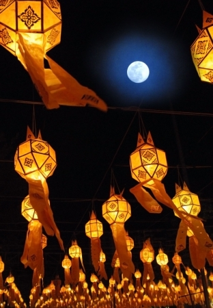 chinese philosophy: A full moon and chinese lanterns at the Loi Krathong festival in Chiang Mai Thailand