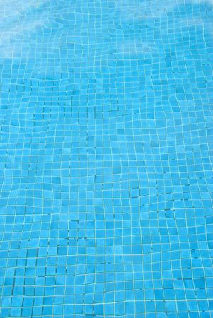 distorted image: An image of the blue bottom of a swimming pool  distorted by water