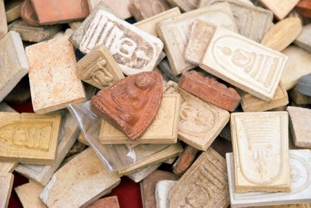Buddhist clay amulets from a market in Bangkok 版權商用圖片