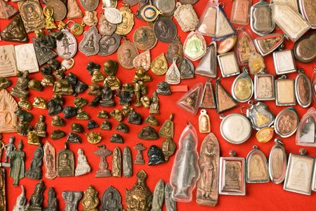 A series of metal and clay Buddhist amulets from a market in Bangkok