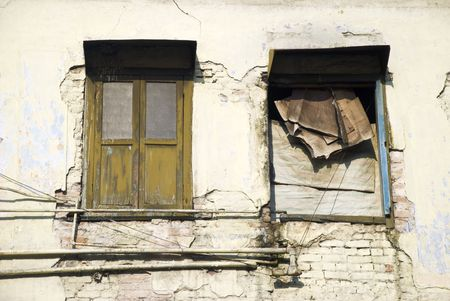 dilapidated: An old dilapidated beige wall
