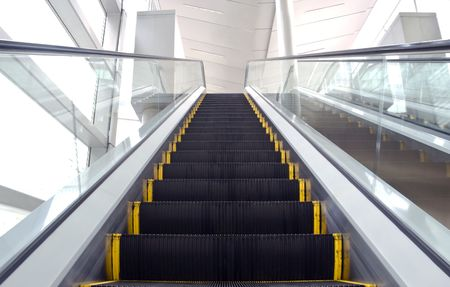 An image of an escalator with some motion blur photo