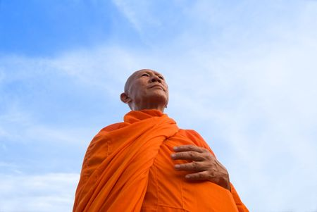 waiting glance: A middle aged Buddhist monk in Thailand Stock Photo