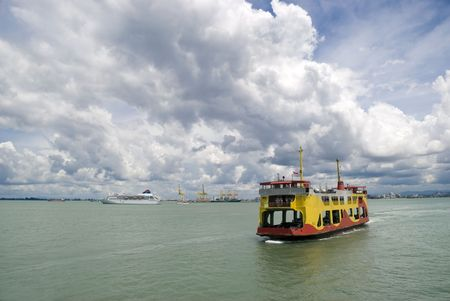 ferry: The Penang (Malaysia) ferry boat doing a crossing between Georgetown and Butterworth on a dramatically cloudy day.