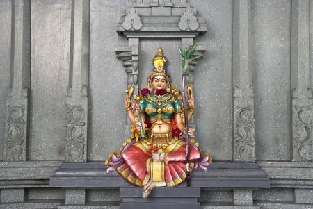 dcor: A colorful stone wall statue of the Hindu deity Lakshmi, Goddess of wealth, prosperity, light, wisdom, fortune, fertility, generosity and courage; and the embodiment of beauty, grace and charm.