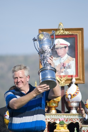 Colin Montgomerie, the captain of the European team holding the Royal Trophy at the Black Mountain Golf Club in Hua Hin, Thailand, on January 9th 2011, after a remarquable comeback.