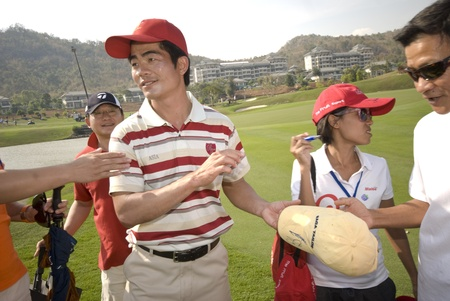 autograph: Hua Hin, Thailand - January 8, 2011. Chinese professional golfer Liang Wen-chong signs autographs at the Royal Trophy Tournament which opposed Europe versus Asia in Hua Hin, Thailand, on January 8, 2011. Editorial